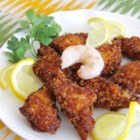 Shrimp Toast II - A shrimp mixture is spread on bread slices, coated with bread crumbs and fried to golden brown. These flavorful appetizers are a unique treat, and they may be made ahead of time and frozen.