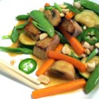 Spicy Pork Stir-Fry - Control the chile and you control the heat in this pork and vegetable stir-fry. Morsels of marinated pork are cooked quickly with ginger, carrots and fresh sugar peas, and then flavored with lime juice, soy, vinegar and sesame oil. Add chile oil to taste.