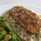 Asian Salmon - Wild salmon is marinated and baked in an Asian-inspired soy and sesame sauce, served with hot cooked rice.