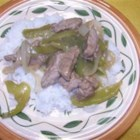 Pepper Steak and Rice - Steak strips are cooked with onion, garlic, and green peppers, and seasoned with paprika.