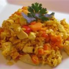Carol's Arroz Con Pollo - Chicken nestled in a melange of saffron rice, wine, vegetables, onion and garlic.