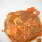 Osso Buco - Osso Buco is an Italian dish made with veal shanks, browned and simmered with tomatoes and vegetables. Traditionally garnished with a mix of chopped raw garlic, parsley, and lemon zest.