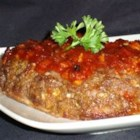 Best Meatloaf in the Whole Wide World! - Pineapple-bacon sauce bakes into a savory ground beef mix to create a sweet, smoky, and savory meatloaf masterpiece.