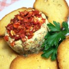 Sun-Dried Tomato Goat Cheese Spread - Tangy young goat cheese is the base for this savory spread. Combined with sun-dried tomatoes, garlic, and fresh parsley. This simple spread is excellent served with a sliced baguette and a glass of red wine.
