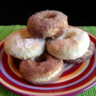 Easy Baked Doughnuts - Homemade baked doughnuts are quick and easy to prepare when using baking mix in the batter. Dip doughnuts in butter and sugar for a sweet finish.