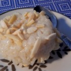 Rice Pudding with Rose Water - Creamy rice pudding with rose water is topped with slivered almonds for rich and floral-scented dessert.