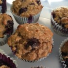 Oat and Blueberry Muffins - Non-fat Greek yogurt and applesauce replace the traditional fats in this blueberry muffin recipe made with unbleached flour and whole-grain oat cereal.