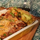 QOB Veggie Enchiladas - Veggie enchiladas coated in a homemade mole sauce and two varieties of cheese make this a perfectly filling dinner everyone will enjoy. Serve alongside Spanish rice and garnish with cilantro.