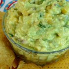 Mango-Tomatillo Guacamole - Mango and tomatillos add layers of flavor to this guacamole recipe also featuring mint. Quick, easy, and delicious.