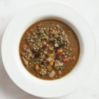 Lentil Soup with Garlicky Vinaigrette - A drizzle of balsamic vinaigrette brightens the rich flavors of this slow-cooker lentil soup with fresh thyme.