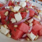 Tisa's Big Top Watermelon Salad - Nothing says summer like juicy watermelon tossed with feta, onions, pine nuts, and fresh herbs.