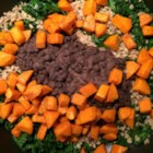 The West Seattle Sweet Potato and Kale Bowl - This roasted sweet potato and kale bowl is topped with barley and coconut black beans for a colorful and tasty vegetarian meal.