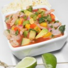 Light and Fresh Mexican Gazpacho - A fresh cold soup with a hint of spiciness has plenty of colorful vegetables including cucumbers, avocados, red and yellow peppers, and cilantro in a tomato base. Add small shrimp to make a nice main course or eat as is for a light lunch or appetizer.