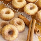Baked Mini Doughnuts - Mini doughnuts that are baked and coated in cinnamon and sugar are a lighter and equally delicious version of doughnuts without the frying!