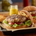 Big Moe's Pork Burgers - Shredded Cheddar cheese, feta cheese crumbles, Worcestershire sauce and hot sauce add great flavor to these succulent grilled pork burgers from Moe Cason.