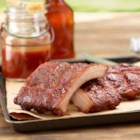 Spicy Smoked Back Ribs with Maple Glaze - Tender pork back ribs are slowly grilled with a spicy rub and maple syrup, then brushed with a sweet and spicy glaze.