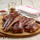 Sweet & Spicy St. Louis Ribs - Dry rubbed with lots of spices--paprika, chili powder, allspice, cinnamon, cloves--these slow-grilled St. Louis-style pork spareribs will star at any summer barbecue.