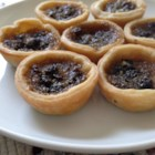 Maple Butter Tarts - Maple-flavored butter tarts are sweet with a smooth flavor and pair well with vanilla ice cream or whipped cream.