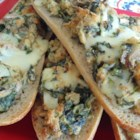 To-Die-For Stuffed Garlic Bread - French bread is stuffed with cheese, butter, garlic, mushrooms, and spinach to create this to-die-for stuffed garlic bread everyone will love.