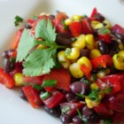 Black Bean and Corn Salad II - A tasty lime dressing, with cayenne and garlic added for kick, make this salad a bit different from the one above. Avocado too. And this salad doesn't need to sit in the frig, it can be served to four hungry people immediately.