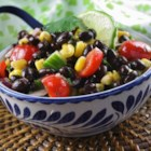 Summer Veggie Salad - Fresh corn kernels, avocado, black beans, and tomatoes are tossed with lime juice and cilantro creating a refreshing summer vegetable salad.