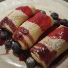 Chef John's Cheese Blintzes - Chef John's cheese blintzes, filled with a lemon ricotta-cream cheese mixture, are perfect for a special brunch. Try them with a fresh berry sauce.