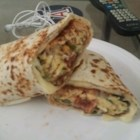 Sausage and Pepper Sunrise Burrito - Sausage and eggs with crisp tender peppers and onions are topped with shredded Cheddar cheese and rolled up in wheat tortillas for a hearty on-the-go breakfast.