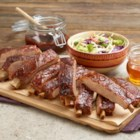 Kansas City Style St. Louis Ribs - Barbecue-seasoned St. Louis ribs are grilled slowly over low heat and brushed with Kansas City-style barbecue sauce.
