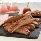 Peach Glazed Ribs - Peach jam, chili sauce and chipotle hot sauce make a sweet and spicy glaze for these tender, slowly grilled spareribs.