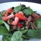 Taco Salad with Spinach - This taco salad uses a bed of spinach instead of tortillas for a lighter version of a taco salad with bell pepper, onion, and mushrooms.