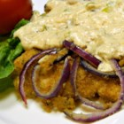 Dreamy Sour Cream and Chive Chicken - Chicken is breaded, baked with red onion, and topped with a delicious sour cream and chive sauce in this easy weeknight dinner recipe.