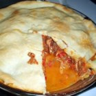 Beef and Pepper Pie - This hearty double-crust pie is filled with a delicious beef mixture that 's simple to make. Sweet red peppers packed in oil are tossed into the blender and then cooked up with ground beef, mushrooms, and cheddar cheese. The pie is then baked until browned and heated through.