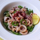 Warm Calamari Salad - Calamari seasoned with 3 kinds of pepper plus jalapeno slices is quickly sauteed and served on arugula and white beans in Chef John's warm calamari salad.