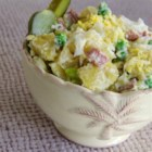 Russian Potato Salad - This is no ordinary potato salad. This salad consists of potatoes, turkey hot dogs, pickles, scallions, hard-boiled eggs, and sweet peas. All of the ingredients are finely chopped and dressed with mayonnaise.  This salad has been in my family for four generations.  Enjoy!
