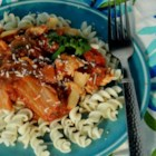 Spicy Kimchi Chicken Rotini - Korean cuisine meets Italian cuisine in this spicy kimchi and chicken rotini recipe that is quick and easy to prepare for a weeknight meal.