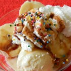 Uncle Sam Banana Split - A big ice cream sundae made with vanilla, chocolate, and strawberry ice cream, bananas, toppings, and candy sprinkles gets a dramatic finish with optional lit sparklers. Say the Pledge of Allegiance before serving!
