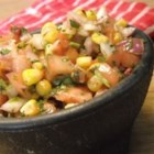 Chipotle and Roasted Corn Salsa - Roasted frozen corn is tossed with fresh vegetables and a chipotle chile dressing to make a great salsa for topping tacos, rolling in burritos, or piling on chips.