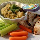 Purple Fiddle Hummus - Traditional hummus gets a little kick when cayenne pepper, cilantro, and cumin are added to the recipe. Serve with veggies and pita chips!