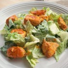 Hot 'n' Spicy Buffalo Chicken Salad - Crisp salad greens are tossed with hot and spicy Buffalo-style chicken bites and a creamy, blue cheese dressing.