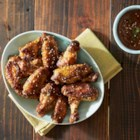 Peanut Sesame Chicken Wings - Chicken wings are broiled in a peanut-honey-lime sauce, topped with sesame seeds, and ready to serve in just minutes.