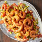 Grilled BBQ Shrimp with Citrus Corn Salad - Marinated shrimp grilled in foil packets with barbeque sauce are served with a colorful and refreshing citrus corn salad.
