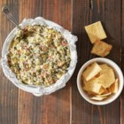 Spinach Artichoke Dip from Reynolds Wrap(R) - Creamy, cheesy spinach-artichoke dip is baked in Reynolds Wrap(R) Pan Lining Paper for easy clean-up.