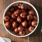 Sweet and Spicy Barbecue Meatballs - The sweet and spicy sauce for these delicious party barbecue meatballs will have your guests coming back for more. And cleanup is easy when you bake the meatballs on Reynolds Wrap(R) Non-Stick Aluminum Foil.