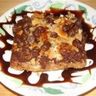 Seven Layer Magic Bars - There's no mixing involved in this easy bar cookie--just layers of buttery graham cracker crumbs, chocolate and butterscotch chips, nuts, coconut, and sweetened condensed milk baked into a rich dessert treat.