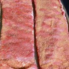 Dry-Rubbed Ribs - Baby back pork ribs are coated in a dry rub made with chili powder, paprika, and brown sugar creating a very flavorful and easy way to prepare ribs.