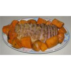 Garlic Pork Roast - A pork roast is slow cooked with sweet potatoes, onion and garlic.