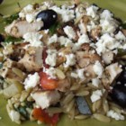 Hot Greek Salad - Top orzo with pan-fried chicken, olives, and sun-dried tomato vinaigrette for a warmed version of Greek salad. Top with feta cheese to complete the meal.