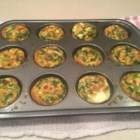 Breakfast Egg Muffins - Make a week's worth of breakfasts good to grab and go with eggs, spinach, bell peppers, jalapeno peppers, and ham.