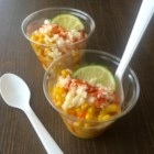 Corn in a Cup (Elote en Vaso) - Elote en vaso, also known as corn in a cup, includes fresh corn, lime juice, crema Mexicana, and cotija cheese for a sweet, crunchy, and hot snack.