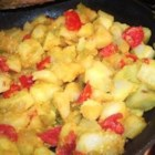 Potatoes with Fresh Ginger and Chilies - Inspired by Indian dishes, potatoes acquire an exotic, zesty personality when cooked in a skillet and tossed with freshly ginger, turmeric, tomatoes, green chile peppers, and fresh curry leaves.